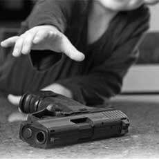 Child reaching for gun.